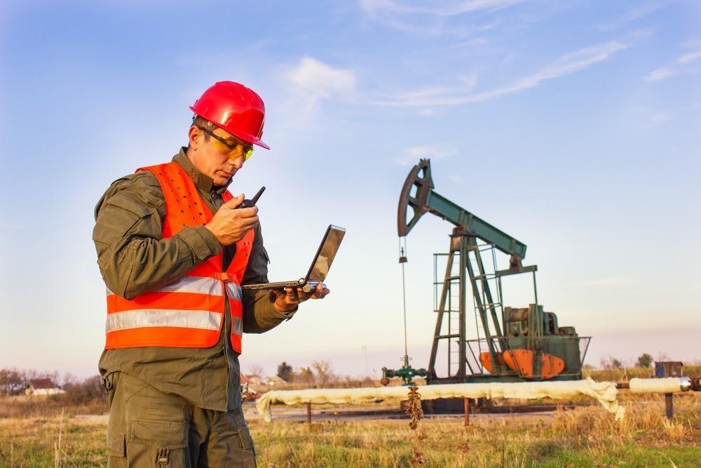 Oil Field Worker On Laptop